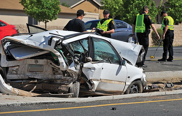 Prescott Valley police officers investigate the scene of a collision on Glassford Hill Road. (Courier, file)