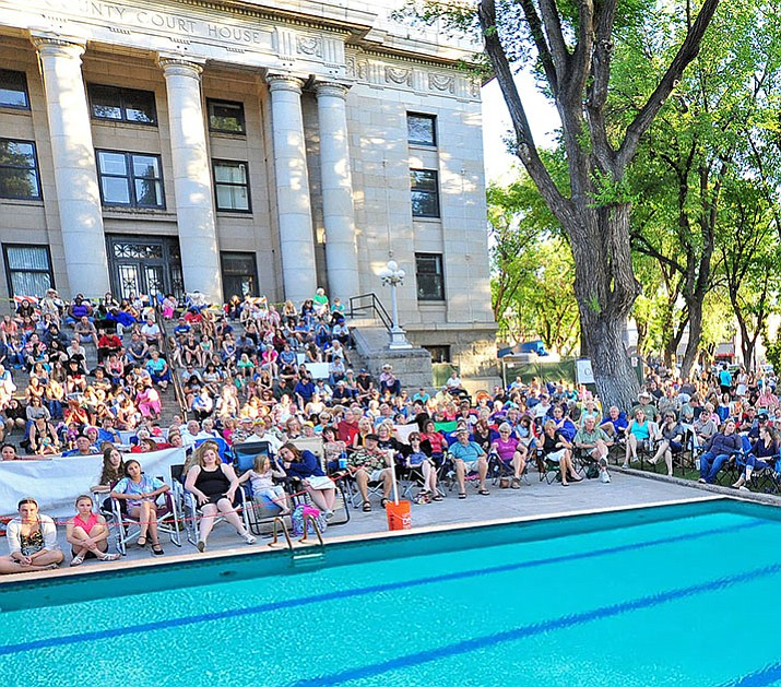 "As depicted in this photo illustration with a Prescott Idol crowd in the background, a voter thinks downtown Prescott needs a swimming pool. ""They should study the events we could have with that,"" he said. However, I like to think he was kidding. (Tim Wiederaenders/Courier illustration)"