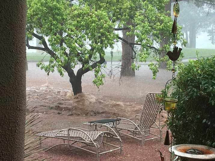 The summer monsoon season wrecked havoc in Village yards and at Oakcreek Country Club. Photo by Gail Simpson