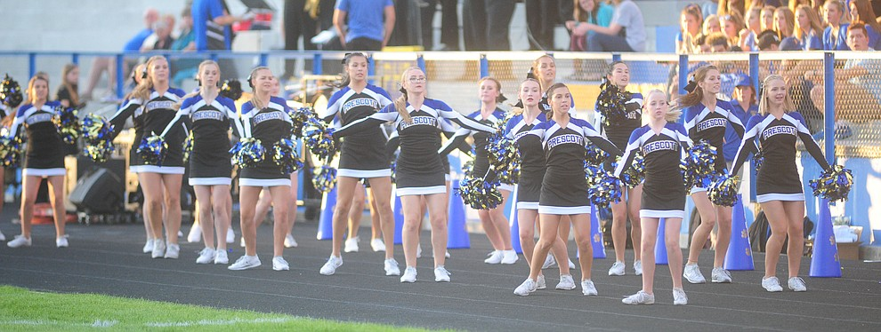 Prescott's cheerleaders open the festivities as the Badgers take on the Marcos de Niza in Prescott Friday, August 25. (Les Stukenberg/The Daily Courier).