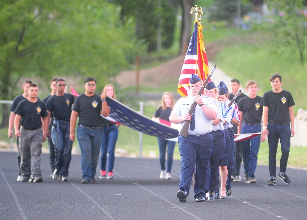 Prescott's JROTC presents the colors as the Badgers take on the Marcos de Niza in Prescott Friday, August 25. (Les Stukenberg/The Daily Courier).