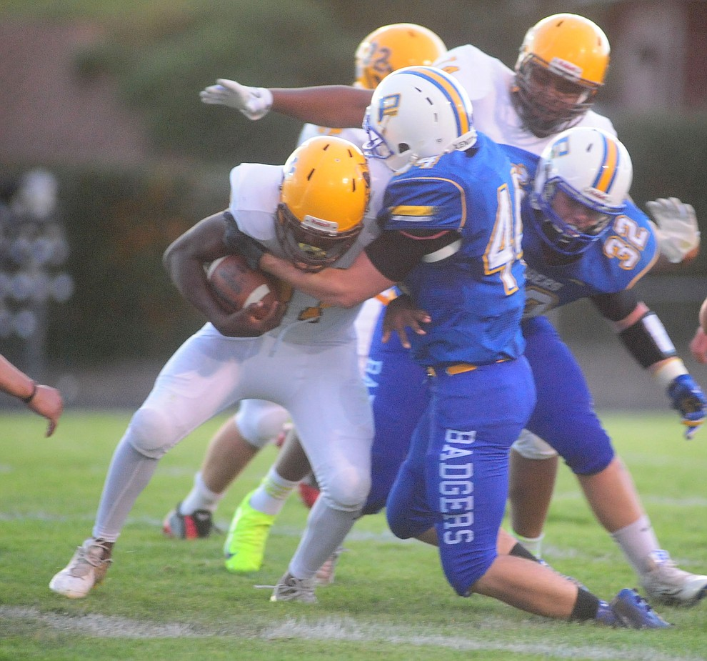Prescott's Jacob Gathman makes a tackle as the Badgers take on the Marcos de Niza in Prescott Friday, August 25. (Les Stukenberg/The Daily Courier).