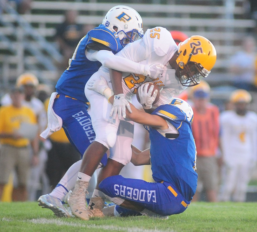 Prescott's Hunter Kronberg and Spencer Newnum make a tackle as the Badgers take on the Marcos de Niza in Prescott Friday, August 25. (Les Stukenberg/The Daily Courier).