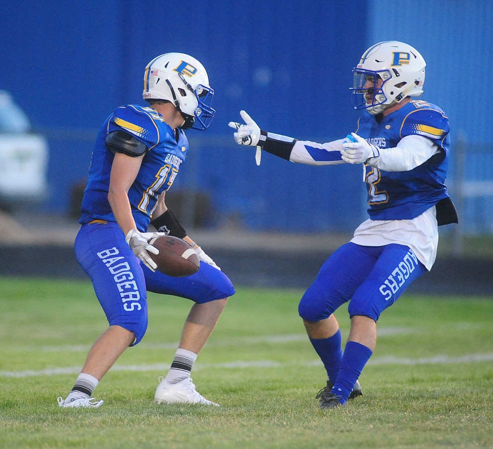 Prescott's Ryan Greene gets congratulated by John Chaffeur after his touchdown run as the Badgers take on the Marcos de Niza in Prescott Friday, August 25. (Les Stukenberg/The Daily Courier).