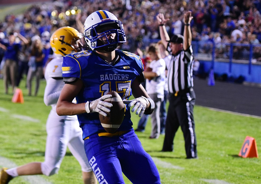 Prescott's Ryan Greene breaks free for a touchdown run as the Badgers take on the Marcos de Niza in Prescott Friday, August 25. (Les Stukenberg/The Daily Courier).