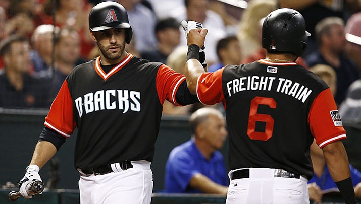 Arizona Diamondbacks' David Peralta (6) celebrates after scoring against the San Francisco Giants, with J.D. Martinez, left, during the third inning of a baseball game Friday, Aug. 25, in Phoenix.