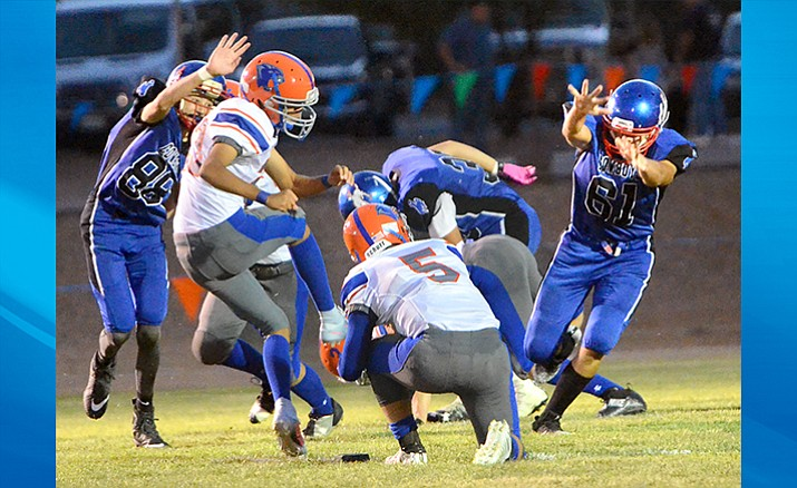 Camp Verde tries to block a Chino Valley extra point attempt during Friday night's 21-14 loss at home. Last year the Cougars beat the Cowboys 52-0. (VVN/Vyto Starinskas)