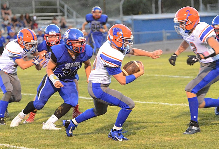 Chino Valley's Jose Mendoza runs for a gain Friday night against Camp Verde.