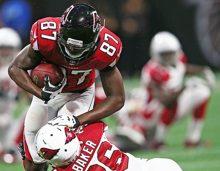 Arizona Cardinals safety Budda Baker tackles Atlanta Falcons wide receiver Deante Burton during the second half Saturday, Aug. 26, in Atlanta. (John Bazemore/AP)