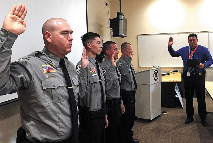 Sheriff Doug Schuster swore in four Detention Officer Graduates Aug. 4 in Kingman.  Pictured left to right:  Michael Powell, Gage Meister, Paul Longstreath, Stephen Wood and Sheriff Schuster.