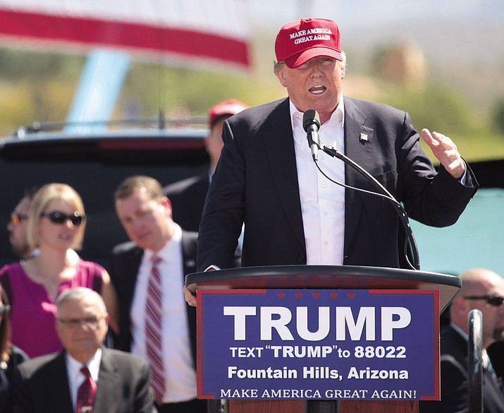 Then-candidate Donald Trump and with ex-sheriff Joe Arpaio while speaking with supporters at a campaign rally in Fountain Hills, Arizona in March 2016.