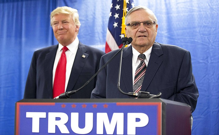 In this Jan. 26, 2016, file photo, Republican presidential candidate Donald Trump, left, is joined by Maricopa County Sheriff Joe Arpaio during a new conference in Marshalltown, Iowa. The White House announced a pardon for Arpaio Friday night, Aug. 25. (Mary Altaffer/AP, File)
