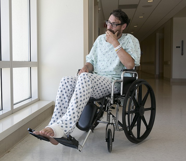 Mathias Steinhuber, of Innsbruck, Austria, who survived being struck by a lighting bolt, pauses while discussing the near-fatal event in Sacramento, Calif. Steinhuber had been hiking the Pacific Crest Trail near Donner Summit Tuesday when he stopped to take a photo and was hit by the lighting. He was taken by helicopter to the the Tahoe Forest Hospital in Truckee, before being flown to the University of California, Davis Hospital Burn Center where he is listed in fair condition. (AP Photo/Rich Pedroncelli)