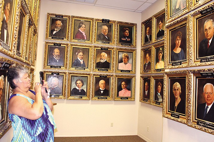 Victoria Goodthunder of Stockton, California takes pictures of the Presidential Gallery portraits inside the Mohave Museum of History and Arts.