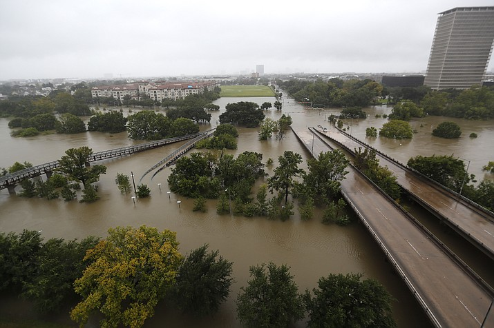 An overhead view of the flooding in Houston, from Buffalo Bayou on Memorial Drive and Allen Parkway, as heavy rains continued falling from Tropical Storm Harvey, Monday, Aug. 28, 2017, in Houston. Houston was still largely paralyzed Monday, and there was no relief in sight from the storm that spun into Texas as a Category 4 hurricane, then parked itself over the Gulf Coast. (Karen Warren/Houston Chronicle via AP)