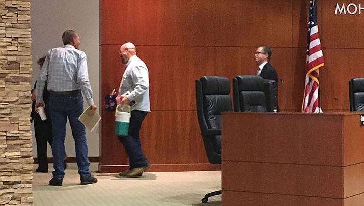 Mohave County Supervisors Gary Watson, left, and Buster Johnson, trailed by County Attorney Ryan Esplin, adjourn into closed session Monday to interview eight candidates to replace District 5 Supervisor Steve Moss, who was appointed to Mohave County Superior Court Judge.