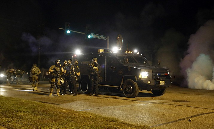 Local police departments will soon have access to grenade launchers, high-caliber weapons and other surplus U.S. military war gear after President Donald Trump signed an order Monday, Aug. 28, 2017, reviving a Pentagon program that civil rights groups say inflames tensions between officers and their communities. (2014 AP Photo/Jeff Roberson)