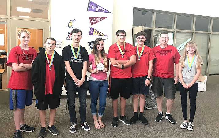 Pictured from left: Seth Davis, Blake Martinez, Logan Masters, Madelyn Fernandez, Zachary Romero, Josh Taflan, coach Brian Green and Paige Cody.