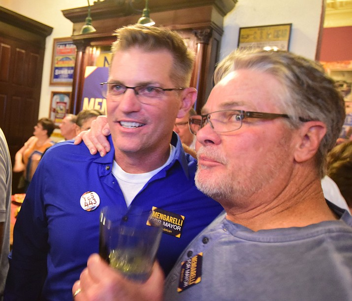 Candidate Greg Mengarelli (left) is congratulated by his friend, Drew Stoddard, after he was the top vote getter in the mayoral election Tuesday, Aug. 29 in Prescott.