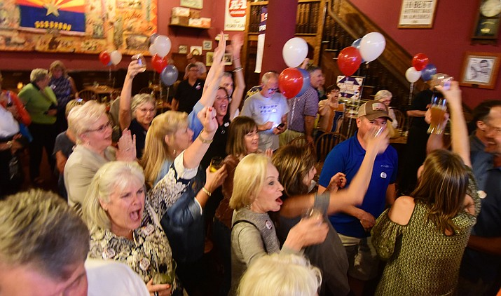 Supporters of Prop. 443 celebrate their victory in the City of Prescott primary election on Tuesday, Aug. 29, 2017, at the Palace Restaurant and Saloon in Prescott.