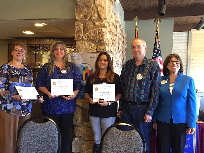 Grand Canyon Rotary members (from left) Laura Chastain, Anavon Harris and Michelle Pahl were recently recognized as Paul Harris Fellows by President Rob Gossard and District Governor Nancy Van Pelt (far right).