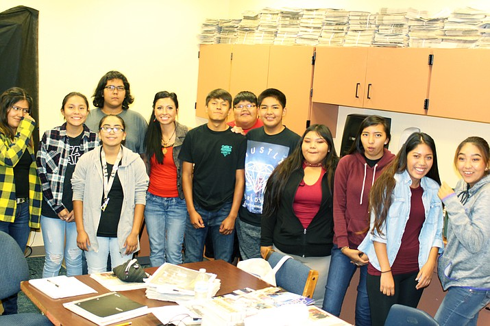 "A journalism class at Hopi Jr/Sr High listens to Loretta Yerian, editor of the Navajo-Hopi Observer, during a recent visit to the class. From left: ShiDaisy Nelson, Ellyse Fredericks, Kuautli Manuelito, Elisa ""Mouth"" Casarez, Loretta Yerian, Adrian Sidney, Kyle Willie, Issac Talas-Lomayaktewa, Aereli ""Air"" Sakeva, Keanna Yoyokie, Priscilla Arjona-Limas and Lucy Nahsonhoya. Stan Bindell/NHO"