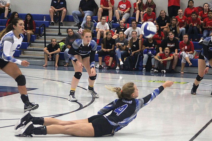 Kingman Academy's Lynsey Day dives to make a dig Tuesday against River Valley. The Lady Tigers swept the Lady Dust Devils, 3-0 (25-8, 25-10, 25-12).