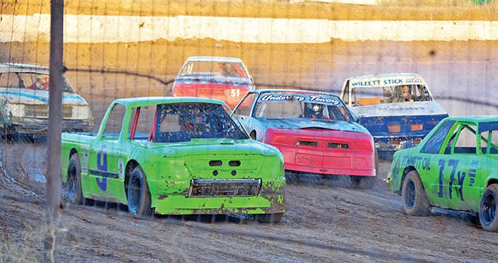 Mini stock cars and trucks make their way through a turn to start of a 2014 race at Prescott Valley Raceway. The track closed in the spring of 2015. A businessman hoped to open a new track in Chino Valley this year, but resistance by residents in the area has him looking for a new location. (Courier file photo)