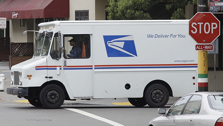 According to federal prosecutors 16 postal workers in Atlanta and the surrounding area accepted bribes to deliver packages of cocaine. The postal workers reportedly provided special addresses on their routes where the drugs could be shipped and then intercepted the packages and delivered them to a person they believed was a drug trafficker. (AP File Photo/Eric Risberg)