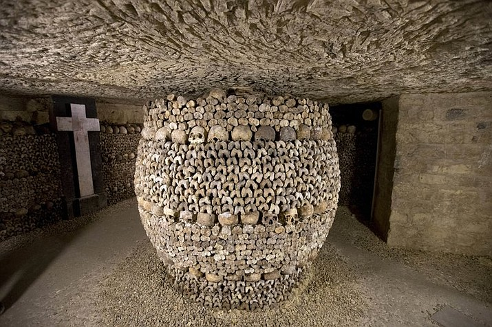 "In this file photo skulls and bones are stacked at the Catacombs in Paris, France. French police say robbers broke into a wine collector's Paris cellar while he was away on vacation, breaking through the cellar wall via the famous ""Catacombs"" network of passages under the city and making off with up to 250,000 euros worth of vintage wines. (AP Photo/Francois Mori, File)"