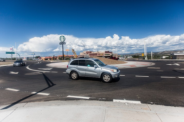 A car travels through an SR 260 roundabout in Camp Verde. They are often thought to be nuisances, however, statistics show that roundabouts are safer than a stoplight. (VVN/Halie Chavez)