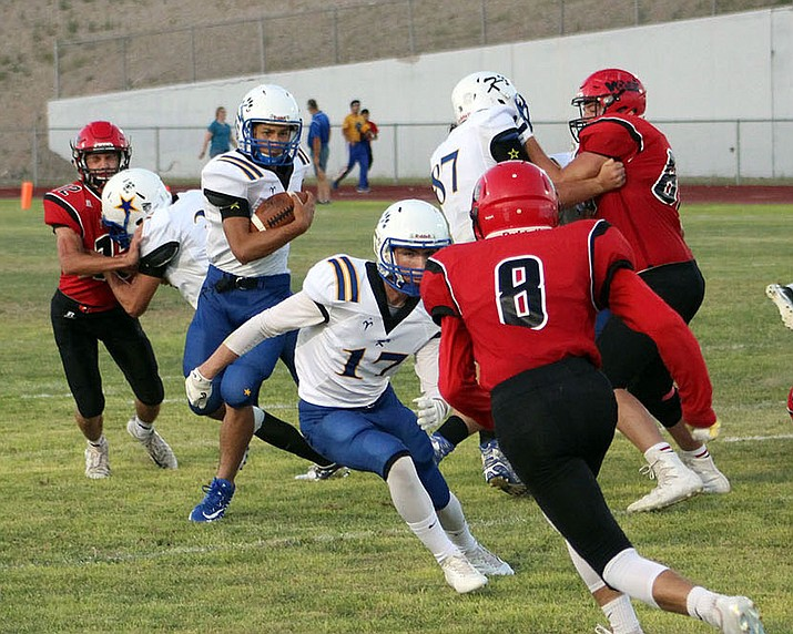 Austin Dias and the Kingman High School football team will take on city rival Kingman Academy at 7 p.m. today. The Tigers won last season's meeting 48-0.