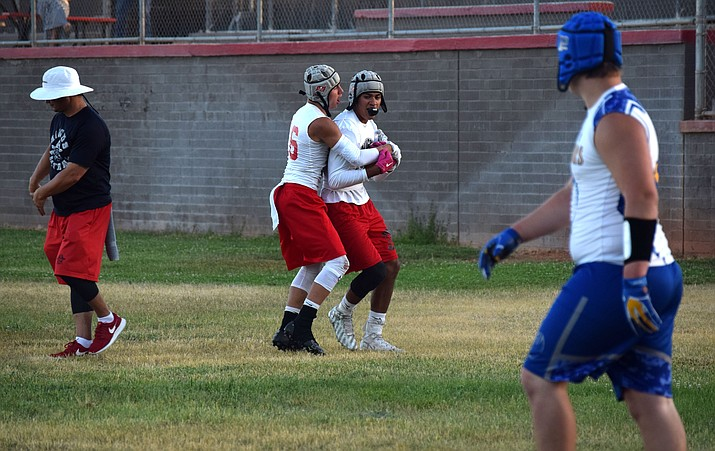 Mingus Union junior Alex Nelson hugs Martin Soria after the senior caught an interception against Prescott in a 7-on-7 game his summer. The AIA ruled that Soria, who transferred from Williams will be ineligible the first five games of the season. (VVN/James Kelley)