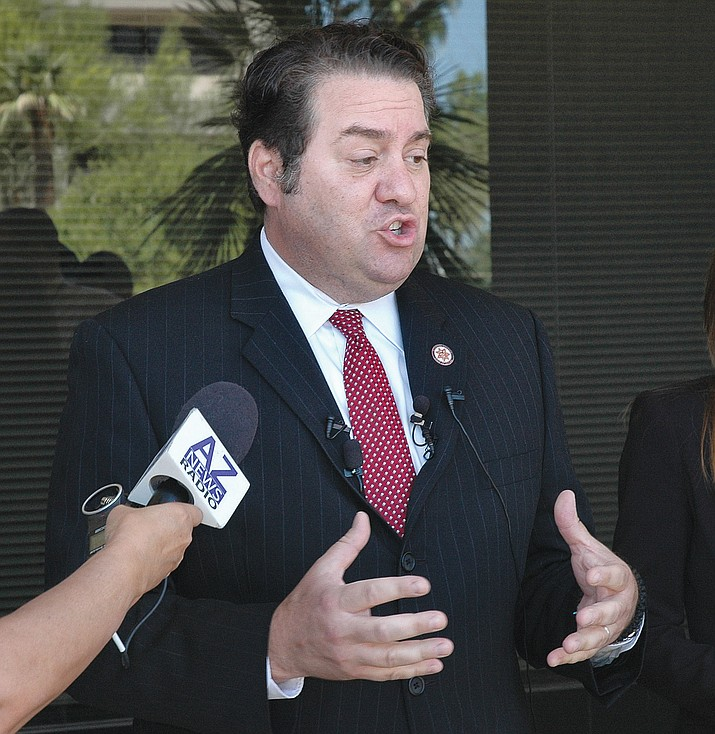 Attorney General Mark Brnovich talks to reporters.