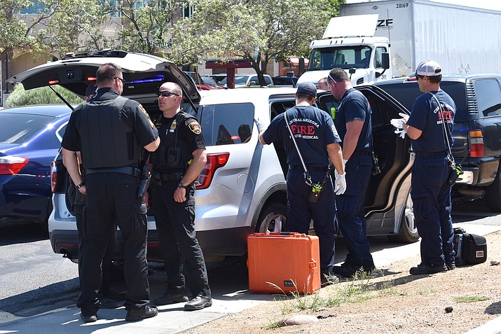 Prescott Valley police officers surround a teen-age girl after she was apprehended on Thursday, Aug. 31. Police said they used a Taser on her to keep her from running into traffic.