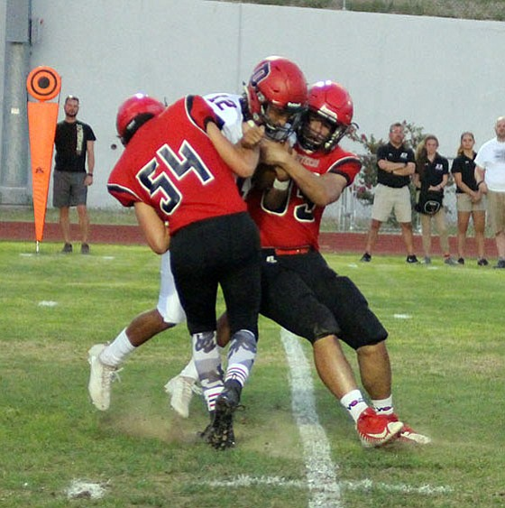 Lee Williams' Matt Shaw (54) and Marco Narvarte sack Dysart's quarterback during the Vols' 22-10 win Friday night.