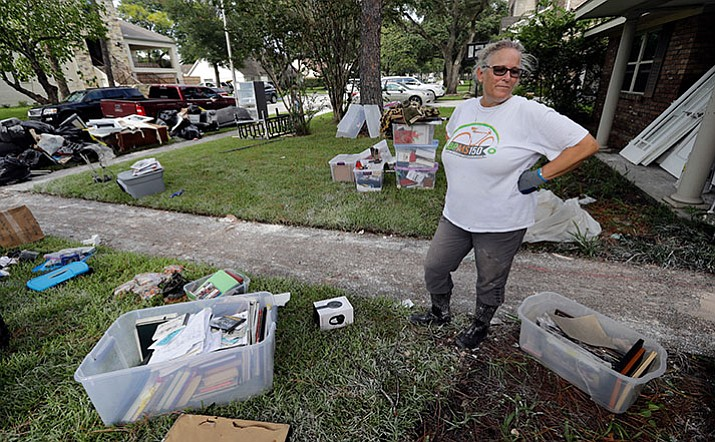 Barron Lazano looks over the damaged to her home and property in the aftermath of Harvey Wednesday in Houston. Harvey did not discriminate in its destruction. It raged through neighborhoods rich and poor, black and white, upscale and working class. Across Houston and surrounding communities, no group sidestepped its paralyzing deluges and apocalyptic floods.(AP Photo/David J. Phillip)