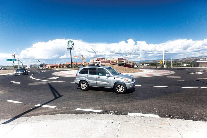 A car travels through an SR 260 roundabout in Camp Verde. They are often thought to be nuisances, however, statistics show that roundabouts are safer than a stoplight.