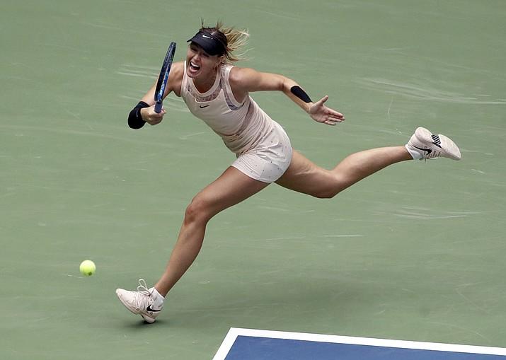 Maria Sharapova, of Russia, returns a shot from Anastasija Sevastova, of Latvia, during the fourth round of the U.S. Open tennis tournament, Sunday, Sept. 3, in New York. (Frank Franklin II/AP)