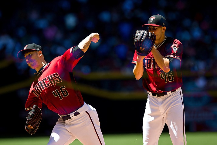 Patrick Corbin and the D-backs defeated the Rockies Saturday to continue their hot streak and maintain their first-place position in the NL wild card race. (Photos by Sarah Sachs/Arizona Diamondback
