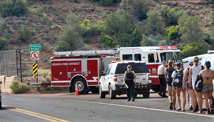 Police and fire officials close off the area around Sedona's Midgley Bridge Saturday following a report of a child who fell down a cliffside from a trail below the bridge. VVN/Vyto Starinskas