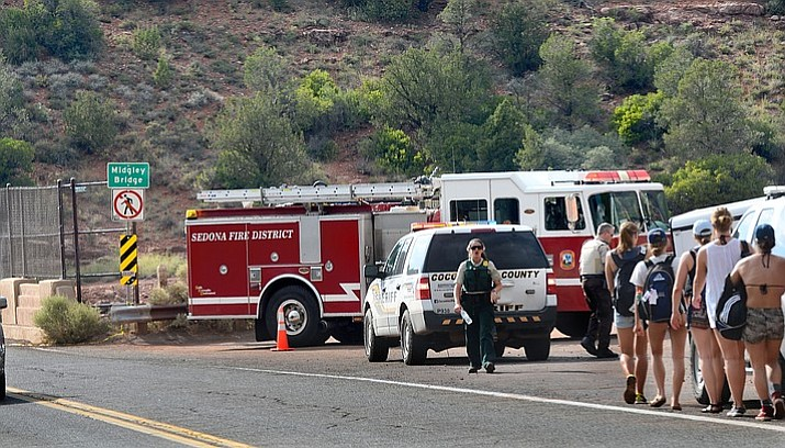 Police and fire officials close off the area around Sedona's Midgley Bridge Saturday following a report of a child who fell down a cliffside from a trail below the bridge. (VVN/Vyto Starinskas)