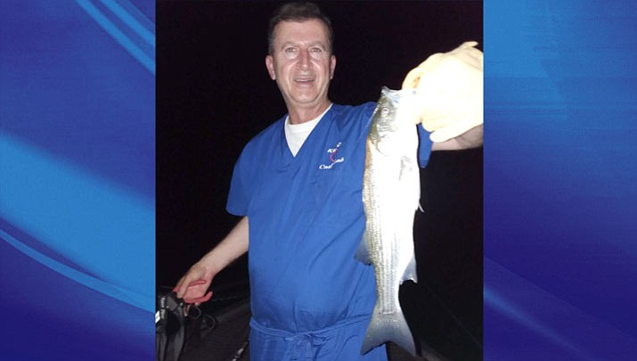 Dr. Saadeh Saadeh with a striper