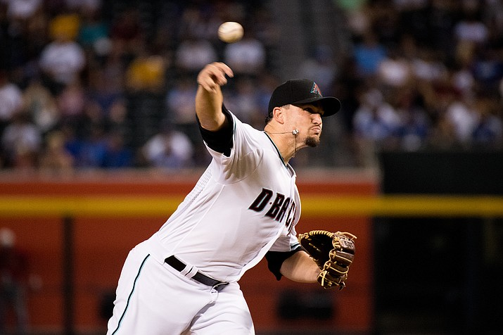 Zack Godley delivers a pitch against the Giants last Wednesday. Godley gave up just three hits over 6 innings to lead the D-backs past the Rockies Sunday, 5-1. The win extended the D-backs' wild-card lead to 6 1/2 games.