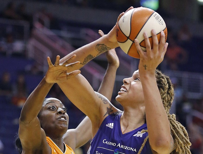 In this May 31, 2016, file photo, Phoenix Mercury's Brittney Griner (42) is fouled as she goes up for a shot against Connecticut Sun's Chiney Ogwumike during a WNBA basketball game in Phoenix. Griner and many other WNBA players and teams are finding their own ways to help Houston and the surrounding area in the aftermath of Hurricane Harvey. (Ross D. Franklin/AP, File)