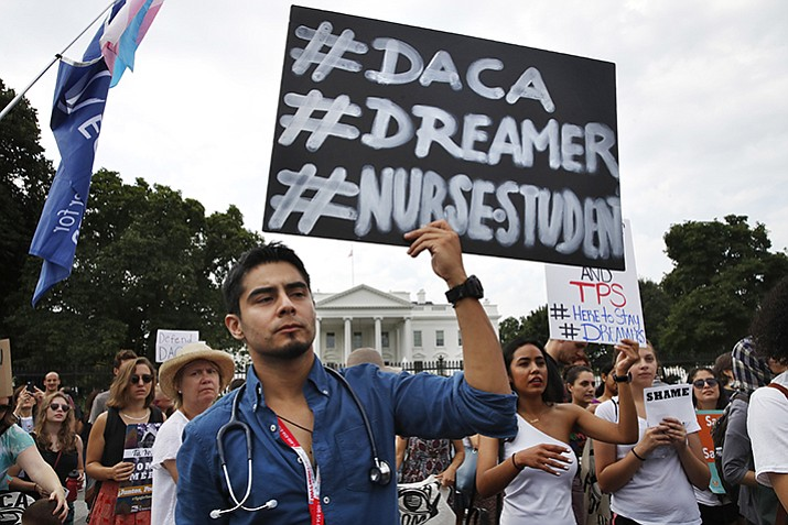 Carlos Esteban, 31, of Woodbridge, Va., a nursing student and recipient of Deferred Action for Childhood Arrivals, known as DACA, rallies with others in support of DACA outside of the White House, in Washington, Tuesday, Sept. 5, 2017. (Jacquelyn Martin/AP Photo)