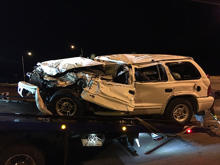 The driver of this SUV was killed Monday evening after he entered the roundabout on Prescott Lakes Parkway and Sundog Ranch Road at a high rate of speed and lost control of his vehicle. Police say the same driver was involved in a hit-and-run crash minutes earlier near Walmart in the 3000 block of Highway 69 in Prescott. (Prescott PD/Courtesy)