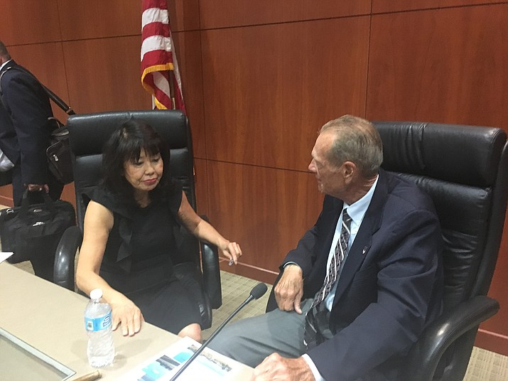 Lois Wakimoto talks to Mohave County Board of Supervisors Chairman Gary Watson on Tuesday after being appointed to replace Steve Moss as District 5 Supervisor.