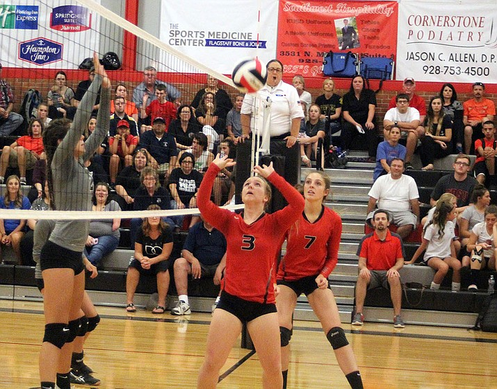 Lee Williams' LaNae Burgess (3) sets the ball Tuesday against River Valley. The Lady Vols swept the Dust Devils to pick up their third win of the year.