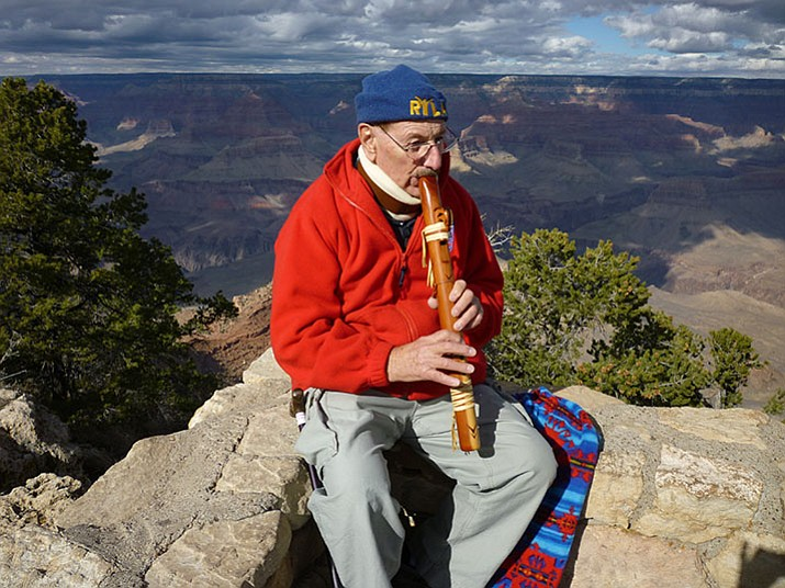 Don Schiller playing his Native American wood flute on the South Rim of the Grand Canyon. (Courtesy)